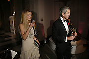 Laura Bailey and Stuart Rose, The British Fashion Awards  2006 sponsored by Swarovski . Victoria and Albert Museum. 2 November 2006. ONE TIME USE ONLY - DO NOT ARCHIVE  © Copyright Photograph by Dafydd Jones 66 Stockwell Park Rd. London SW9 0DA Tel 020 7733 0108 www.dafjones.com