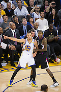 LA Clippers guard Jamal Crawford (11) grabs onto Golden State Warriors guard Stephen Curry (30) at Oracle Arena in Oakland, Calif., on February 23, 2017. (Stan Olszewski/Special to S.F. Examiner)