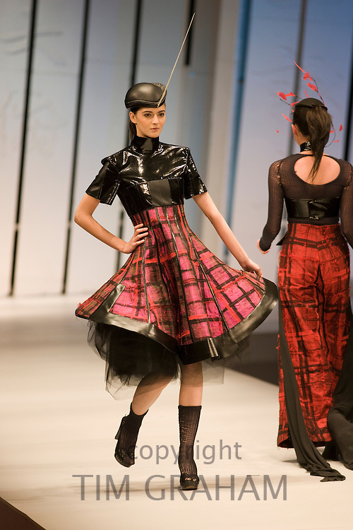Young woman models designer clothes in opening show of China Fashion Week at the Beijing Hotel, China