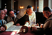 Reading from the Torah, the holiest book in Judaism, Jews celebrate the Sabbath at the Choral Synagogue in Moscow. During Cold War, the status of Jews was a major human rights issue, with American trade restrictions imposed by Congress tied to the level of Jewish emigration. Beginning in 1989, Soviet President Mikhail Gorbachev relaxed restrictions on religious practice and approved the beginning of a massive Jewish exodus.  © Steve Raymer / National Geographic Creative