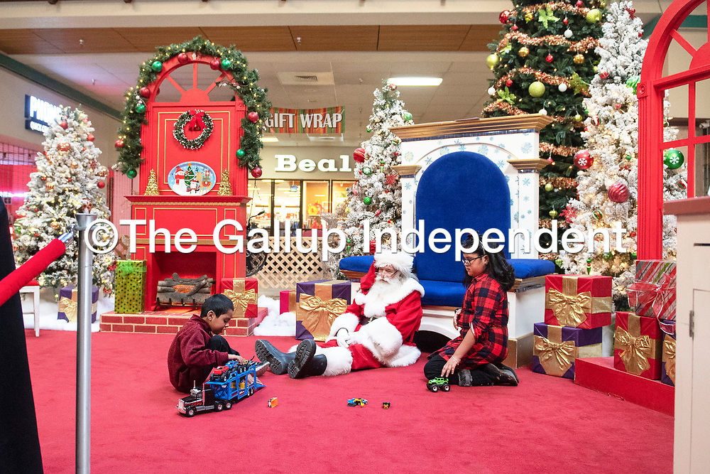 Siblings Samone, 10, right and Ramone Montelongo, 8, left, visit with Santa Claus, Sunday Dec. 9 at Rio West Mall before the mall opens to the public. Rio West Mall partnered with Autism Speaks to host it's first Santa Cares event in Gallup, an event for kids with special needs.