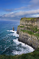 The Cliffs of Moher are located at the southwestern edge of the Burren region in County Clare, Ireland. They rise 120 metres (390 ft) above the Atlantic Ocean at Hag's Head, and reach their maximum height of 214 metres (702 ft) just north of O'Brien's Tower, eight kilometres to the north.