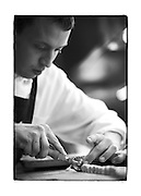 SHOT 12/11/10 3:15:35 PM - Chef Merick Devine hand cuts agnolotti at Frasca Food and Wine in Boulder, Co. Frasca is a highly-rated neighborhood restaurant inspired by the cuisine and culture of Friuli, Italy. Historically found throughout Friuli, Frascas were friendly and informal gathering places, a destination for farmers, friends, and families to share a meal and a bottle of wine. Identified by a tree branch hanging over a doorway portal, they were a symbol of local farm cuisine, wine, and warm hospitality. (Photo by Marc Piscotty / © 2010)