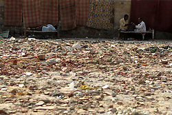 Playing cards and sleeping next to a rubble pile in Delhi India.  The Commonwealth Games are being held in Delhi India between the 3rd and 14th October 2010..Photoby:  Ron Gaunt/SPORTZPICS