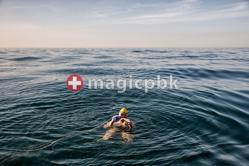 Gino Deflorian of Switzerland drinks and eats a Nutella sandwich after 8 Hours of swimming while crossing the English Channel in 11 Hours 6 Minutes from Samphire Hoe (Great Britain) to Cap Gris Nez (France) at the beach in Cap Gris Nez, France, Tuesday, Aug. 20, 2013. Gino Deflorian is the first Swiss male swimmer who successfully swims the English Channel and the third Swiss. (Photo by Patrick B. Kraemer / MAGICPBK)