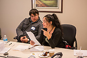 Purchase, NY – 31 October 2014. Peekskill High School students Emmett  Warmbrand and Ariel Ortiz discuss a point. The Business Skills Olympics was founded by the African American Men of Westchester, is sponsored and facilitated by Morgan Stanley, and is open to high school teams in Westchester County.