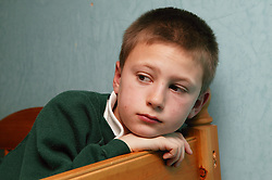 Young boy looking thoughtful,