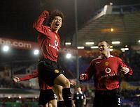 Photo: Glyn Thomas.<br />Birmingham City v Manchester United. Carling Cup.<br />20/12/2005.<br /> Manchester United's Ji-Sung Park (L) celebrates after scoring his team's second goal.