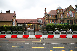 © Licensed to London News Pictures. 29/08/2020. London, UK. Barriers are erected for social distancing at the entrance of Chestnuts Primary School in Tottenham, north London, as the school prepares for reopening next week, at the start of the new academic year. The council and the school are putting in place measures for social distancing and safe conditions following the coronavirus pandemic. Photo credit: Dinendra Haria/LNP