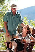 Deanna and Ken enjoy a laugh on their deck at the cottage, Anderson Lake, BC