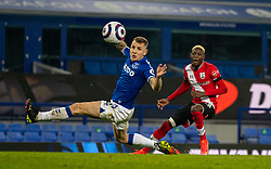 LIVERPOOL, ENGLAND - Monday, March 1, 2021: Southampton's Moussa Djenepo sees his shot deflected wide during the FA Premier League match between Everton FC and Southampton FC at Goodison Park. Everton won 1-0. (Pic by David Rawcliffe/Propaganda)