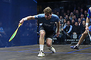 Charles Sharpes of England (in the Green shirt) with a shot against Simon Rosner of Germany (in the white shirt). Canary Wharf Squash Classic 2016 , day two at the East Wintergarden in Canary Wharf , London on Tuesday 8th March 2016.<br /> pic by John Patrick Fletcher, Andrew Orchard sports photography.