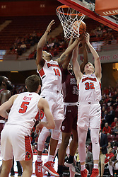08 February 2018:  Phil Fayne, Kavion Pippen and Taylor Bruninga all work for possession of a rebound during a College mens basketball game between the Southern Illinois Salukis and Illinois State Redbirds in Redbird Arena, Normal IL