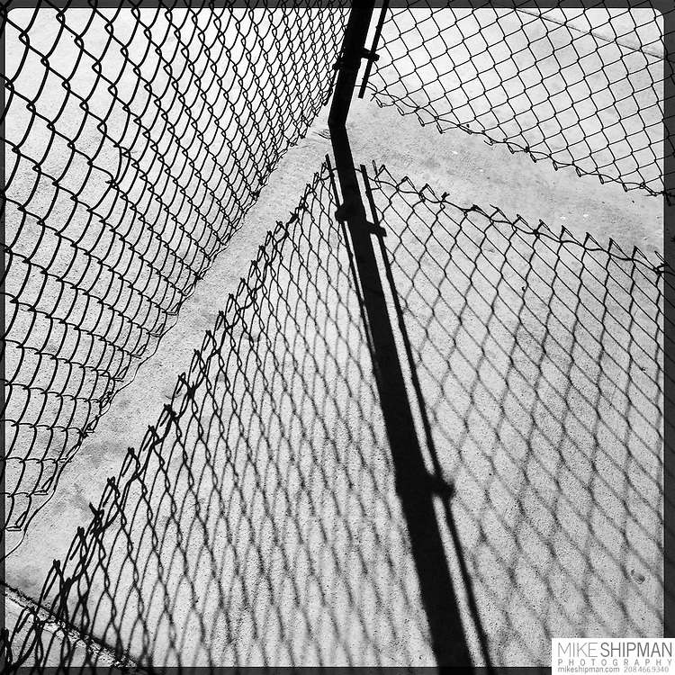 Shadows cast by chain link fence