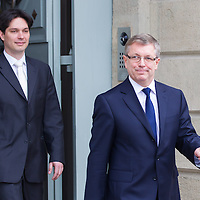 Hungary's newly minted central bank Governor Gyorgy Matolcsy (R) and his deputy Adam Balog (L), also newly appointed for the central bank leave the presidential palace after his swearing-in ceremony in Budapest, Hungary on March 06, 2013. ATTILA VOLGYI