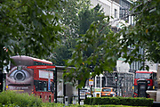 A number 17 London bus drives through the City of London with a large eye on the rear urging motorists to reduce their speeds on the capitals roads on 24th June 2021, in London, England.