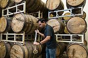 Virag Saksena takes a sample of whiskey at 10th Street Distillery in San Jose, California, on September 4, 2019. (Stan Olszewski for Content Magazine)