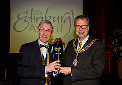 Pictured: <br /> Edinburgh Award for 2016 presented to Ken Buchanan at the city chambers by Lord Provost Lord Donald Wilson. A ceremony at the City Chambers for the recipient of this year's award, Ken Buchanan, who was presented with a Loving Cup by the Lord Provost. He was also reunited with his hand-prints which have been set in a flagstone within the grounds of the City Chambers and see his name etched on the city's Edinburgh Award honour board <br /> <br /> Scott Louden | EEm 3 March 2017