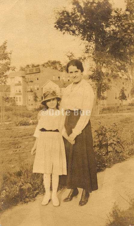 A mother and here daughter posing for a photograph
