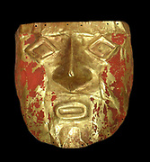 Death Mask from the Moche people of Peru, circa 600-1000 AD. The red colour is vermilion a mercury bearing pigment used to delay decomposition of the face.
