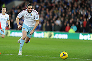 West Ham's Andy Carroll in action.  Barclays Premier league, Cardiff city v West Ham Utd match at the Cardiff city Stadium in Cardiff, South Wales on Saturday 11th Jan 2014.<br /> pic by Andrew Orchard, Andrew Orchard sports photography.