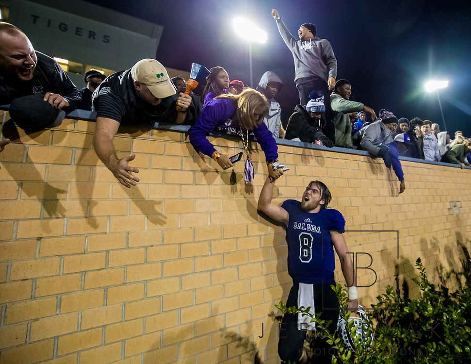 Saluda Tigers quarterback Noah Bell (8) celebrates with fans after winning the Class AA State Championship game against the Barnwell Warhorses. 2019 Saluda State Championship Football Photos
