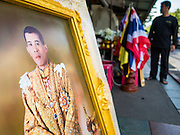 01 DECEMBER 2016 - BANGKOK, THAILAND:  A portrait of Crown Prince Vajiralongkorn, who will soon be the new King of Thailand, for sale in Bangkok. Thailand's parliamentary body, the National Legislative Assembly, invited HRH Crown Prince Maha Vajiralongkorn to be king following the death of the Crown Prince's father, Bhumibol Adulyadej, the Late King of Thailand. The invitation marked the formal beginning of the process of naming the new King, although Crown Prince Vajiralongkorn was the heir apparent and Bhumibol's appointed successor. Shops that sell royal paraphernalia are now selling new portraits of  Crown Prince Vajiralongkorn which will be displayed alongside portraits of his late father. King Bhumipol died on Oct 13.     PHOTO BY JACK KURTZ