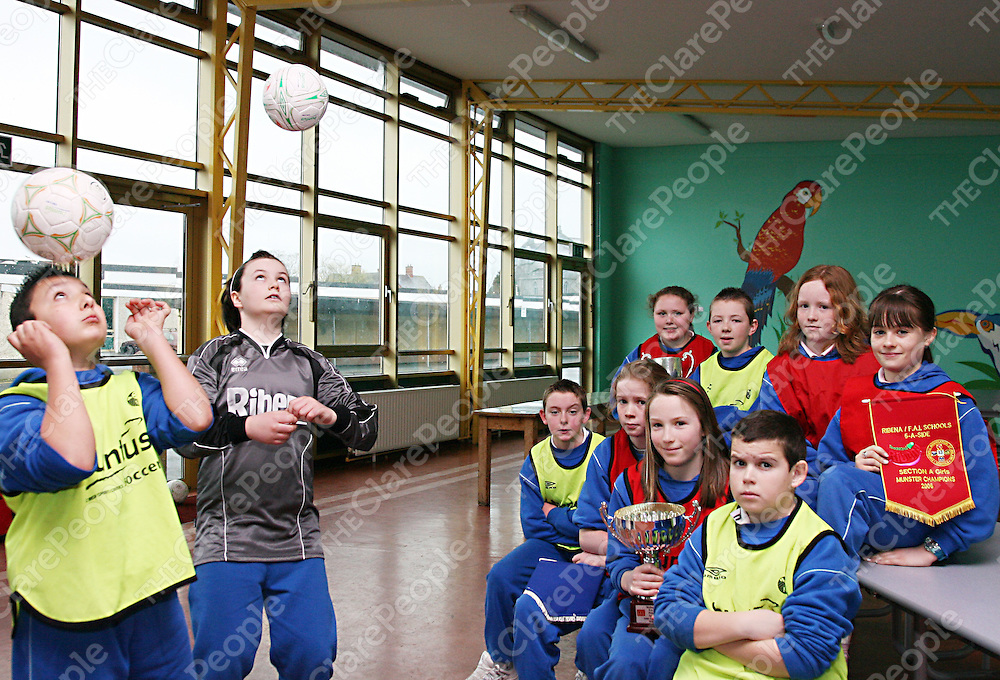 Students of the Holy Family N.S Denis Lup and Kate Feehan entertain Ciara Phillips, Johathon Kennedy, Aoife O' Neill, Haley Connelly, David Conroy,Alison Brogan, Laoise Roche and James Stack at the launch of the Ribena five aside soccer camp during the week.<br /><br /><br /><br />Photograph by Yvonne Vaughan.