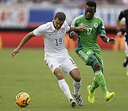 JACKSONVILLE, FL - JUNE 07:  Midfielder Graham Zusi #19 of the United States is challenged by midfielder Ogenyi Onazi #17 of Nigeria during the international friendly match at EverBank Field on June 7, 2014 in Jacksonville, Florida.  (Photo by Mike Zarrilli/Getty Images)