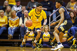Dec 8, 2018; Morgantown, WV, USA; West Virginia Mountaineers guard James Bolden (3) dribbles the ball in the corner during the first half against the Pittsburgh Panthers at WVU Coliseum. Mandatory Credit: Ben Queen-USA TODAY Sports