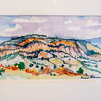 A watercolor landscape painting from artist David Montelongo's is one of many at Montelongo's gallery show at Art123 in Gallup Friday.