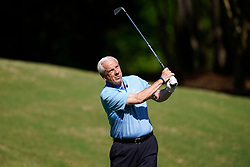 North Carolina head basketball coach Roy Williams tees off during the Chick-fil-A Peach Bowl Challenge at the Ritz Carlton Reynolds, Lake Oconee, on Tuesday, April 30, 2019, in Greensboro, GA. (Paul Abell via Abell Images for Chick-fil-A Peach Bowl Challenge)