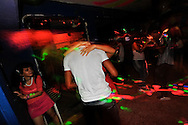 A man and woman dance in a discotec in the Los Ejecutivos area of Cartagena, Colombia. This coastal city boasts many bars and discotecs where foreign tourists can drink, dance, and pick up prostitutes. A sex scandal erupted recently when secret service agents were found bringing prostitutes to their hotel rooms while in Cartagena preparing for President Barack Obama's arrival to the Summit of the Americas.