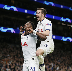 LONDON, Nov. 27, 2019  Tottenham Hotspur's Serge Aurier (L) celebrates his goal during the UEFA Champions League Group B match between Tottenham Hotspur and Olympiakos at the Tottenham Hotspur Stadium in London, Britain on Nov. 26, 2019..FOR EDITORIAL USE ONLY. NOT FOR SALE FOR MARKETING OR ADVERTISING CAMPAIGNS. NO USE WITH UNAUTHORIZED AUDIO, VIDEO, DATA, FIXTURE LISTS, CLUB/LEAGUE LOGOS OR ''LIVE'' SERVICES. ONLINE IN-MATCH USE LIMITED TO 45 IMAGES, NO VIDEO EMULATION. NO USE IN BETTING, GAMES OR SINGLE CLUB/LEAGUE/PLAYER PUBLICATIONS. (Photo by Matthew Impey/Xinhua) (Credit Image: © Han Yan/Xinhua via ZUMA Wire)