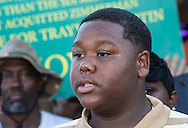 """Cameron Sterling, whose father, Alton Sterling, was killed by the police in Baton Rouge called for peace and for all people to be a """"united family"""" at a press confernce at the store in Baton Rouge where his father was died."""
