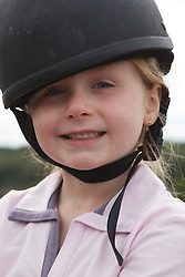 Portrait of girl at riding lesson.