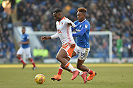 Blackpool Midfielder, Viv Solomom-Otabor (17) holds off Portsmouth Forward, Jamal Lowe (18) during the EFL Sky Bet League 1 match between Portsmouth and Blackpool at Fratton Park, Portsmouth, England on 24 February 2018. Picture by Adam Rivers.