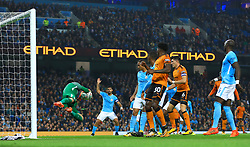 Manchester City's Sergio Aguero has an attempt at goal saved by Wolverhampton Wanderers goalkeeper Will Norris during the Carabao Cup, Fourth Round match at the Etihad Stadium, Manchester.