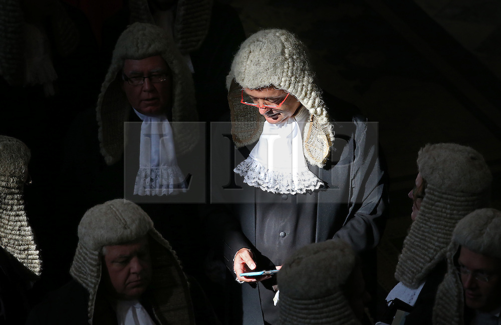 © Licensed to London News Pictures. 01/10/2015. London, UK. A judge uses his phone in Westminster Abbey before taking part in the annual Judges Service. The Service heralds the start of the legal year in the United Kingdom. Photo credit: Peter Macdiarmid/LNP