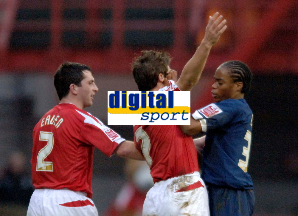 Photo: Glyn Thomas.<br />Nottingham Forest v Walsall. Coca Cola League 1.<br />10/12/2005.<br />Walsall's Ishmel Demontagnac (R) punches Forest's Nicky Southell in the face, for which he was shown the red card.