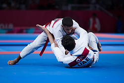 JAKARTA, Aug 24,2018  Hamad Nawad (top) of the UAE competes against Khalid ALblooshi of the UAE during the Ju-Jitsu Newaza Men's -56 kg Final - Gold Medal competition of the 18th Asian Games in Jakarta, Indonesia, Aug. 24, 2018. Hamad Nawad won the match and got the gold medal. (Credit Image: © Zhu Wei/Xinhua via ZUMA Wire)