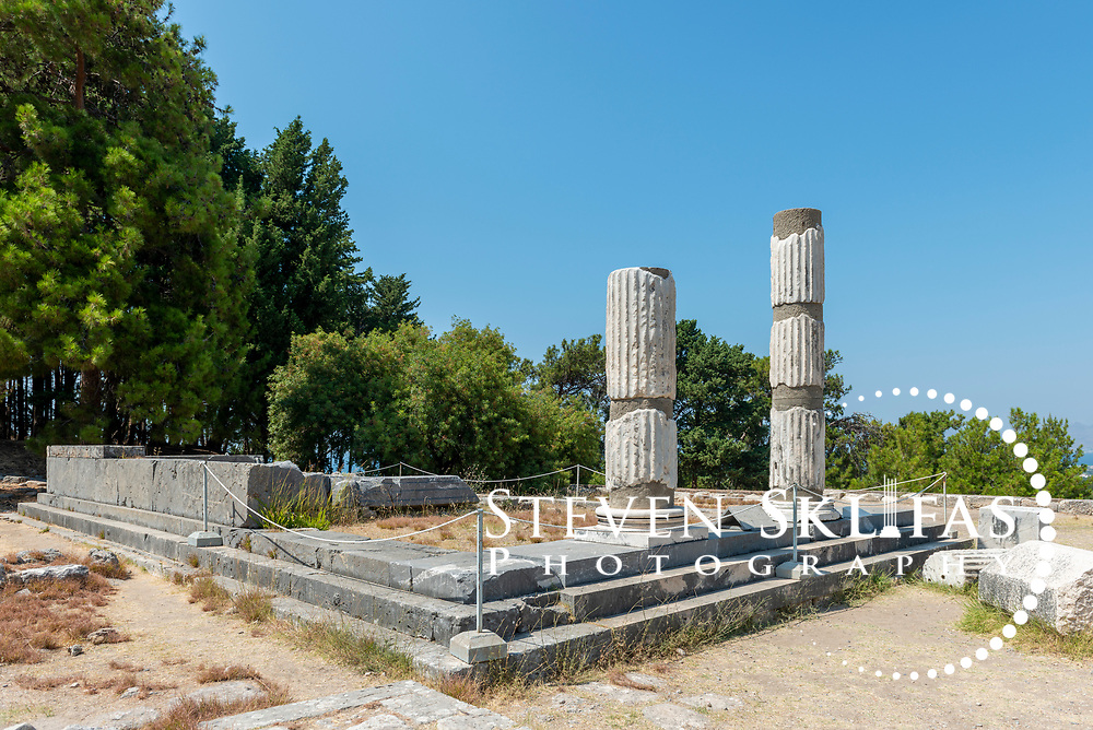 View of the two upright columns of the 4th century Ionic order Temple of Asklepios. This image was captured at the Asklepieion, the sanctuary of Asklepios, the Greek god of medicine and healing and son of Apollo. It lays 3.5 kilometers north-west of Kos Town and stands on the slopes of a low hill and enjoys a superb view over the sea and the coast of Asia Minor (Turkey) opposite.