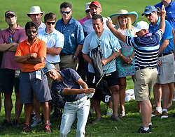 Rickie Fowler hits his ball onto the 15th green during first-round action of the PGA Championship at Quail Hollow Club on Thursday, Aug. 10, 2017, in Charlotte, N.C. (Photo by Jeff Siner/Charlotte Observer/TNS/Sipa USA)  *** Please Use Credit from Credit Field ***