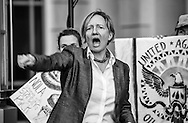 Anne Rolfes, director of the Louisiana Bucket Brigade heads up a rally before a permit hearing for the Bayou Bridge Pipeline.