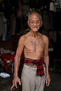 A tattooed man in a Siem Reap market, in Cambodia. PHOTO TIAGO MIRANDA