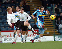 Photo: Kevin Poolman.<br />Wycombe Wanderers v Hereford United. Coca Cola League 2. 01/01/2007. Russell Martin of Wycombe just gets to the ball before Hereford's Andy Ferrell.