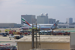 American Airlines Boeing 757 Airplane Emergency Evacuation At LAX Airport After Smoke Was Detected In The Cabin On A Flight To Honolulu With Emirates Airline r Landing In Background