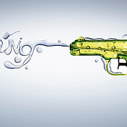 A Childs water pistol toy spelling out the word 'Bang' in water being fired from the gun. Image by Stuart Freeman Hype Photographer.