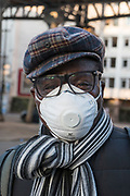 """March, 23rd 2020 - Paris, Ile-de-France, France: Parisians wearing a range of masks and facial coverings in the hope of protecting themselves from the spread of the Coronavirus, during the eigth day of near total lockdown imposed in France. A week after President of France, Emmanuel Macron, said the citizens must stay at home from midday on Tuesday for at least 15 days. He said """"We are at war, a public health war, certainly but we are at war, against an invisible and elusive enemy"""". All journeys outside the home unless justified for essential professional or health reasons are outlawed. Anyone flouting the new regulations is fined. Nigel Dickinson"""