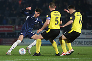 Isaac Hutchinson takes on Jake Buxton and Kieran Wallace during the EFL Sky Bet League 1 match between Burton Albion and Southend United at the Pirelli Stadium, Burton upon Trent, England on 3 December 2019.